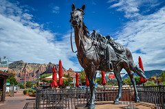 Main Street, Sedona, AZ (Zozo's Photos) Tags: nikon nikond7000 sigma sigma1835mm arizona az sedona mountains redrock landscape landscapevista red orange blue statue mainstreet horse sigmaart