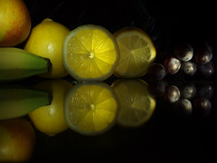 fruit on glass (brian teh snail) Tags: fruit yellow still reflection banana apple lemon grapes glass