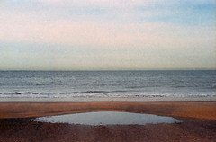 The Mini Sea (selyfriday) Tags: selyfriday wwwnassiocomempty nassiocom nikon nikonfm 50mmf18 eseries c41 fujifilm 35mm fuji netherlands nederland dutch holland sea northsea minisea puddle beach coast water holyshititsacolourpicture