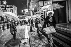 Just Move (Mario Rasso) Tags: mariorasso japan japon tokyo tokio shibuya nikon d810 rain umbrella street streetphotography urban urbano girl blackandwhite