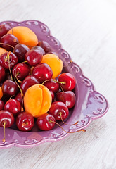 Plate of summer fruits (♥Oxygen♥) Tags: apricot food fresh healthy closeup plate ripe sweet vitamins bowl cherries fruits ingredients kitchentable many rustic stilllife background cherry delicious fruit red tasty assortment bright calorie eat fructose juicy lifestyle lot low natural orange