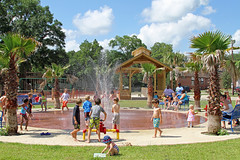Splash Pad that is part of the improvements made directly behind the old school building (FAIRFIELDFAMILY) Tags: park blue school light boy summer sky house playing jason tree sc boys water fountain girl playground clouds barn carson children fun outside design nice pretty day child play grant south hill lawn young pad style ground treehouse taylor carolina daycare splash care hobbit childcare turpin ridgeland hobit splashpad hobitt