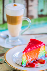 Layer rainbow cakes and cappuccino coffee (anekphoto) Tags: from above wood old light red portrait food white cup coffee yellow cake vintage cherry table wooden rainbow break view tea sweet chocolate space plate retro worn layer rest elevated teacup cappuccino scratched orientation copy overhead saucer capuchin