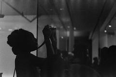 TK Wonder, taking a picture (slightheadache) Tags: 3200 art artopening bw blackandwhite boohooray boohooraygallery chelsea diy diyordie diyordieevent dub ep expiredfilm film handmade ilford ilforddelta3200 lp manhattan milk milkgallery newyork newyorkcity pentax pentaxk1000 punk recordcovers records reggae dark exhibition grain grainy stencil tkwonder quanntwins tkquann fashion