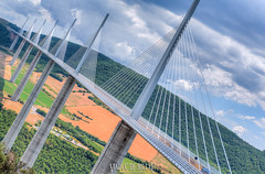 Millau Viaduct (Viaduc de Millau), Aveyron, Midi-Pyrenees, France (Stewart Leiwakabessy) Tags: bridge people france architecture river high roadtrip structure viaduct pylon cables saturation tarn fr a75 hdr highdynamicrange newcar millau multiexposure viaduc aveyron midipyrenees midipyrnes stewartleiwakabessy viaducdemillau photomatix rivertarn cablestayedbridge arcadis bracketed tonemapped michelvirlogeux brianfoster peugeot308 stewartleiwakabessy labastidepradines n7roadtrip provence2014