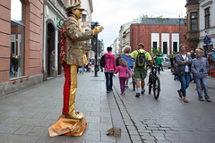 Man of Gold Seeking Coins_4809 (hkoons) Tags: city people walking europe coins country nation performance poland krakow pedestrian polish beggar pedestrians krakw cracow folks walkers panhandler easterneurope beg panhandle