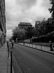 Rue de Fourcy (willwalters19) Tags: road street morning trees light blackandwhite bw white man black paris france green seine clouds de europe le bags fourcy rue marais carrying lemarais ruedefourcy mancarryingbags