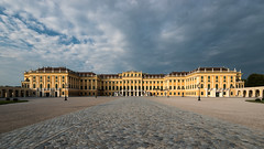 Schönbrunn Palace (Philipp Klinger Photography) Tags: schönbrunn vienna wien morning travel blue trees windows light vacation sky panorama orange cloud holiday storm tree window yellow stone architecture clouds facade sunrise austria österreich nikon warm europa europe angle cloudy stones widescreen wide warmth wideangle stormy nopeople palace symmetry cobble symmetrical kaiser schloss 169 philipp d800 klinger schlossschönbrunn habsburg schönbrunnpalace empereor habsburger nikond800 philippklinger