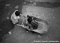KIDZ (Bashir Osman) Tags: pakistan bw monochrome kids mono blackwhite bambini trolley kinder niños enfants karachi sindh paquistão باكستان дети bashir 巴基斯坦 balochistan çocuklar پاکستان παιδιά travelpakistan 파키스탄 kinders baluchistan pakistán کراچی indusvalleycivilization パキスタン الاطفال pakistanichildren childrenofpakistan pakistanikids пакистан карачи bashirosman gettyimagesmiddleeast كراتشي καράτσι કરાચી कराची aboutpakistan aboutkarachi travelkarachi પાકિસ્તાન পাকিস্তান pakistāna pakistanas بچوں haedos bashirusman