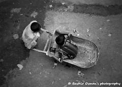 KIDZ (Bashir Osman) Tags: pakistan bw monochrome kids mono blackwhite bambini trolley kinder nios enfants karachi sindh paquisto   bashir  balochistan ocuklar   travelpakistan  kinders baluchistan pakistn  indusvalleycivilization   pakistanichildren childrenofpakistan pakistanikids   bashirosman gettyimagesmiddleeast     aboutpakistan aboutkarachi travelkarachi   pakistna pakistanas  haedos bashirusman