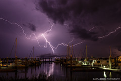 Lightning over Fernandina Beach Marina, Amelia Island, Florida (DawnaMoorePhotography) Tags: travel storm reflection nature water night sailboat marina boats harbor boat dock unitedstates florida bolt strike bolts lightning atnight fernandinabeach af