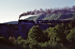 Loco 45001  |  Eregli, Turkey TCDD  |  1989 by keithwilde152 - Leaving the Black Sea coast section behind, train 06.45 Eregli-Armutcuk headed by 2-8-0 45001 storms gradients near the homesteads of Keskek approaching destination. This isolated TCDD industrial railway conveying mined coal to the Eregli steel mills was abandoned and lifted in the 1990s.  13th May 1989