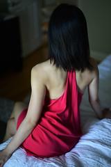 Red (DodogoeSLR) Tags: red dress slip natural light model asian pose legs crossed window strong athletic bed dof bokeh mini short nikon nikkor 50mmf14