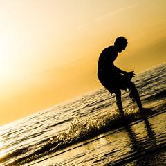 Skimboarding @ Zaandvoort Beach (vnkht) Tags: sunset sunlight black netherlands sunshine silhouette strand square lumix evening raw dusk thenetherlands 11 panasonic squareformat 90mm skimboarding zandvoort 2012 noordholland lightroom f63 nederlanden skimming northholland skimboarder iso80 zandvoortaanzee zandvoortbeach lx5 dmclx5 lightroom5 gavinkwhite