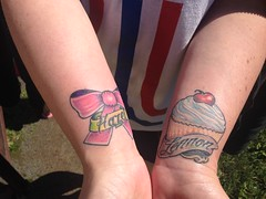 cupcake and bow name tattoos by wes fortier - Burning Hearts Tattoo Co. 1430 Meriden Rd.  Waterbury, CT