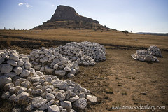 MASS BRITISH GRAVES AT ISANDLWANA, NATAL, SOUTH AFRICA. (IMAGES OF WALES.... (TIMWOOD)) Tags: africa natal canon river army buffalo memorial war gun spears south 1800s battle lord graves empire cannon clubs guns british wars battlefield mound invasion baron shields drift chelmsford gattling 1879 anglo drakensberg bloodshed zululand lordcarnarvon connical cetshwayo garnetwolseley zulukwazulu tugelo
