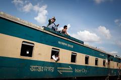 Rooftop ride (Lil [Kristen Elsby]) Tags: travel topf25 train asia topv1111 transport railway editorial dhaka dailylife bangladesh southasia travelphotography intercitytrain kawranbazar canon5dmarkii