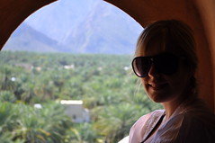 Milli and the date plantations (charlottehbest) Tags: light shadow mountains window silhouette palms scenery view plantation archway date february oman milli 2014 charlottehbest