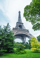 La Tour Eiffel in Paris surrounded by trees in summer (gagliardiphotography) Tags: city travel blue summer vacation sky urban panorama paris france building tower tourism monument seine skyline architecture river french site europe european cityscape tour view symbol outdoor famous capital sightseeing scenic landmark eiffel tourist panoramic destination romantic historical embankment attraction