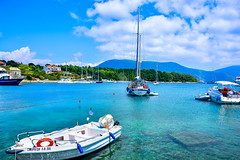A View from Fiskardo... (Photo_hobbyist) Tags: blue sea sky green water clouds port boats marine ngc greece yachts traveling vacations kefallonia ionian fiskardo eptanisa phiskardo