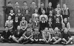 Class Photo (theirhistory) Tags: uk school girls boys playground socks shirt children outdoors glasses photo shoes group tie skirt class junior gb zipper specs jumper shorts form wellies blazer primary pupils