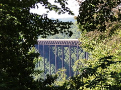 New River Gorge Bridge and Rapids (Jim Mullhaupt) Tags: road bridge wild summer vacation holiday water sport danger river high nikon highway rapids rafting westvirginia coolpix jumper raft bungy overlook newrivergorge us19 p510 mullhaupt jimmullhaupt