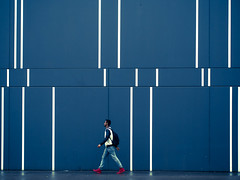 red shoes (Sandy...J) Tags: olympus street streetphotography walking wall lines man colors blue architecture photography alone fassade germany