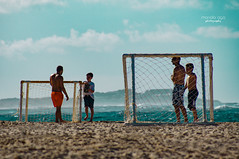 Ah ... I need vacation asap (mariola aga) Tags: puntacana dominicanrepublic bavaro atlanticocean beach ocean shoreline sand water waves men boys tourists game relax soccer footballgoal goal vacation candid closeup