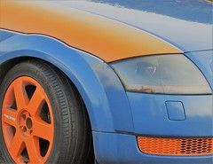 ORANGE AND BLUE REFLECTIONS (Poppy Cocqué ღ) Tags: closeup section car orange blue orangeandblue poem poetry prose soundtrack rusty rumi heincooper ap poppy poppycocqué orangeandbluereflections house reflections shiny motor vehicle tyre wheel radiator grille lamp headlight headlamp metal plastic rubber contrast textures textural abstract abstraction alloys light voiture allarewelcome audi