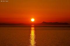 Sunset over the peninsula Akrotiri (dreptacz) Tags: morze zachód słońce widok pomarańczowy crete wyspa sony55 slt55 lustrzanka góry odbicie sonyflickraward flickrunitedaward