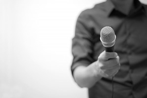 Man holding microphone by stevebustin, on Flickr