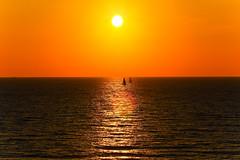 sunset & sailboats - Hertzelia beach - Israel (Lior. L) Tags: sunset sea orange reflection beach weather canon reflections israel mediterranean shadows seascapes horizon silhouettes telephoto flare sailboats striking mediterraneansea shimmering shimmer telephotolens canon70200f4l greatweather orangesunset hertzelia horizonbeach canon600d strikingsunset sunsetsailboatshertzeliabeachisrael