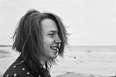 Beach Portrait (Ken-Mac) Tags: portrait bw film beach olympus grainy ilford shootfilm