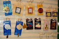 Disneyland Pin Purchases - 2014-07-17 - World of Disney - Limited Edition Pin Display Case (drj1828) Tags: ariel us anniversary disneyland hanging rapunzel dangle limitededition dlr 59th disneypintrading disneyparks eaudemagique