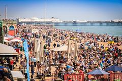 Brighton Seafront in the Summer (Jon & Katia) Tags: sea summer beach canon eos pier brighton hove crowd busy 1d seafront tamron sunbathing mkii 18200mm