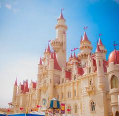 A Castle Far Far Away (MohammadHasan) Tags: blue sky panorama sunlight castle 35mm beige nikon singapore bright flags clear fairy universal studios bangladesh tale uss d90