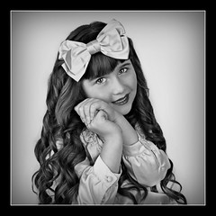 Sweetie-Pie B&W (Portrait Central) Tags: light portrait brown white black girl kids hair studio children photo kid long photographer child dress little photos sweet central young curls professional lolita curly photograph bow pageant