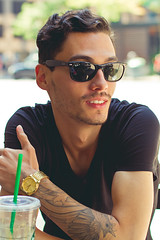 Matthew  (Shandi-lee) Tags: city light boy summer portrait urban sunlight white toronto ontario canada man black reflection male green love boyfriend nature smile sunshine sunglasses yellow tattoo composition neck happy gold ray natural candid watch tan handsome naturallight nixon depthoffield starbucks hispanic brunette blacktshirt zara rayban tanned 50mmf14 sunnies raybans bans matthewrodriguez canoneos7d shandilee shandileecox youngprinceversace