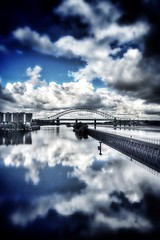 It's so fluffy... (Grains of Rice) Tags: sky water clouds reflections river hdr mersey iphone runcorn manchestershipcanal runcornbridge pseudohdr iphonography snapseed