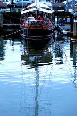 Santa on vacation (R. Leu - ) Tags: santa reflection water digital ed boat olympus wharf f18 omd 75mm em5 mzuiko