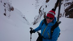 mike after a boot pack to ski a classic chute in patagonia