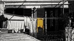(mazzottaalessandra) Tags: monocromo giallo colorazione selettiva vestiti otranto balcone bucato life style canon contrast urban view maglione centro storico nero bianco