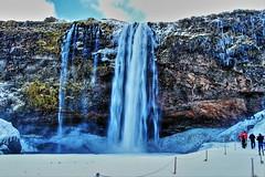 Skogafoss (Albert Jafar) Tags: skogafoss waterfall icelandssouthcoast winterscenery snow iceland cliff photographerswharf worldtrekker fantasticnature people