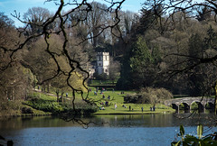 View Across the Lake (clive_metcalfe) Tags: stourhead stourton wiltshire uk lake bridge church trees sunshine spring daffodils branches wall nationaltrust