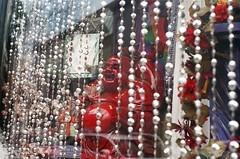 Beads Over Buddha (DRodino) Tags: decorations film window shop analog laughing shopping beads display pentax k1000 buddha saratoga saratogasprings pentaxk1000 jolly jovial