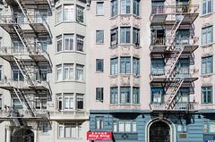 San Francisco -  apartments on Hyde Street (MikePScott) Tags: sanfrancisco california camera usa house window sign stairs buildings logo lens arch apartment flat flag banner condominium builtenvironment architecturalfeatures nikon1424mmf28 nikond800 featureslandmarks