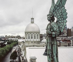 Hier Encore, Vieux Montreal (jpcastonguay) Tags: old city roof blur green mamiya film rooftop up statue closeup angel clouds mediumformat wings cityscape dof close cloudy quebec pov montreal ange chapel historic depthoffield poet historical medium oldmontreal 90mm crypt march aznavour publicmarket notredamedebonsecours vieuxmontreal bonsecours rb67 mamiyarb67 film