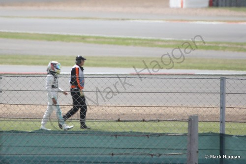Lewis Hamilton walks away from his stranded car during Free Practice 2 at the 2014 British Grand Prix