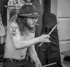 And the drummer was SMOKIN' (Bazzography! kind of back in action) Tags: leica ireland irish galway hat tattoo glasses blackwhite smoking drumstick specs drummer drumming busker smoker spectacles trilby barechest baretorso leicac