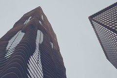 Waves At The Sky (hartsaw) Tags: city sky urban chicago building water vertical architecture skyscraper design illinois aqua downtown waves minolta sony 28mm lookingup celtic alpha upward chicagoarchitecture a5000 aquatower raddisonbluaqua